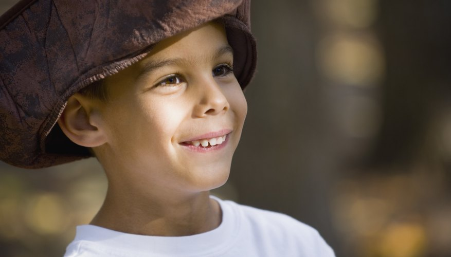 Close-up of child wearing pirate hat.