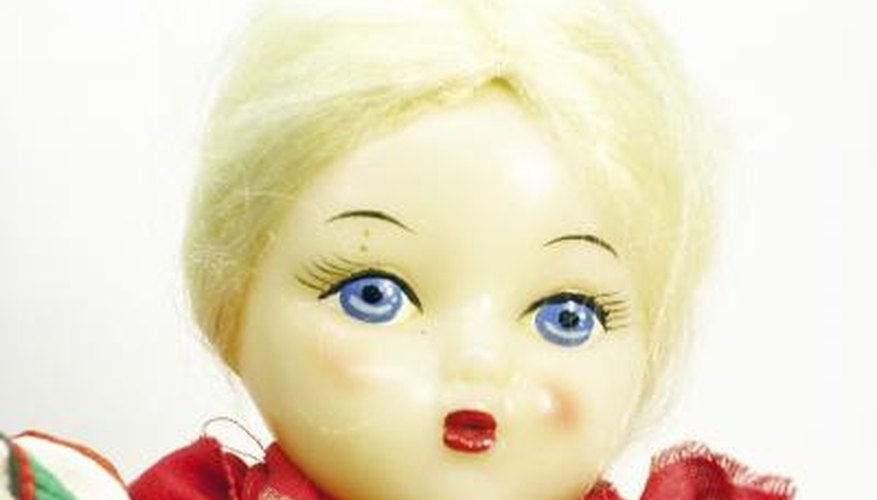 Make your very own doll face out of craft supplies.