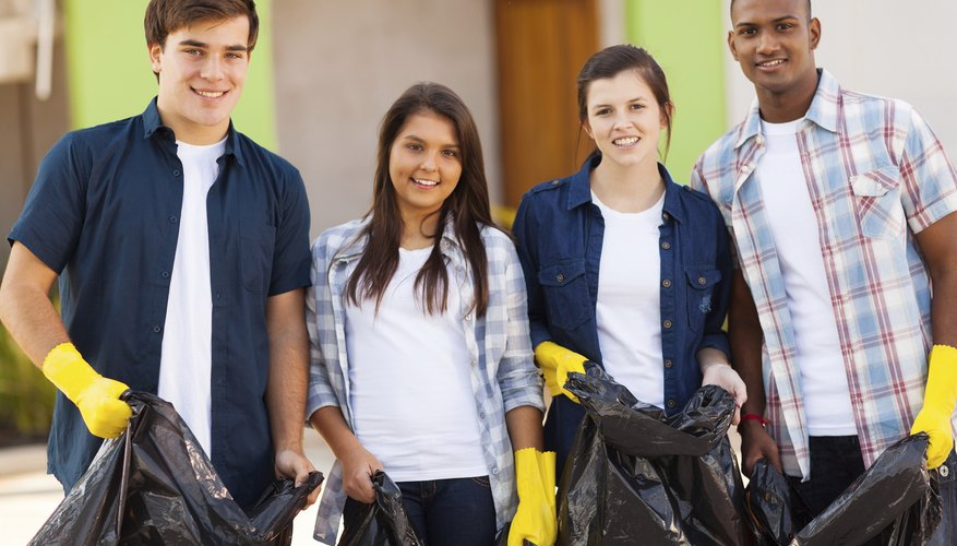 Teens volunteering with garbage bags