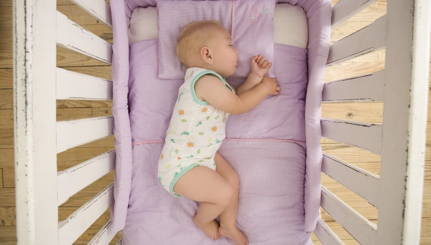 High angle view of a baby sleeping in a crib.