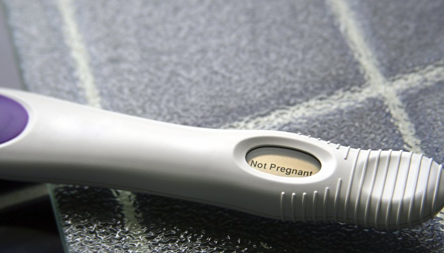 A close-up of a home pregnancy test on tile.