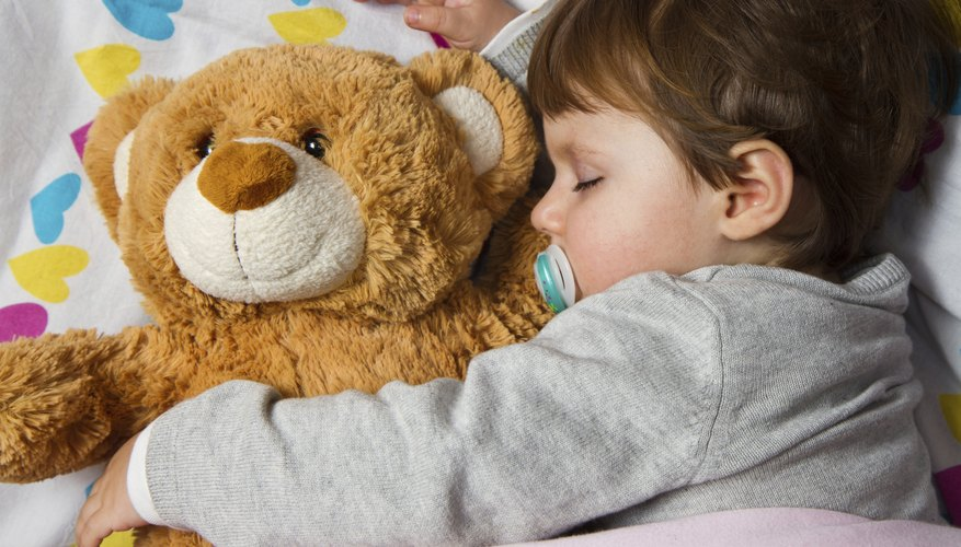 toddler napping with stuffed animal