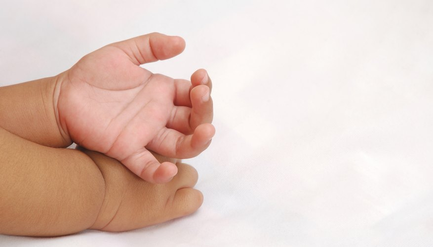 Your baby's hands won't stay small for long.