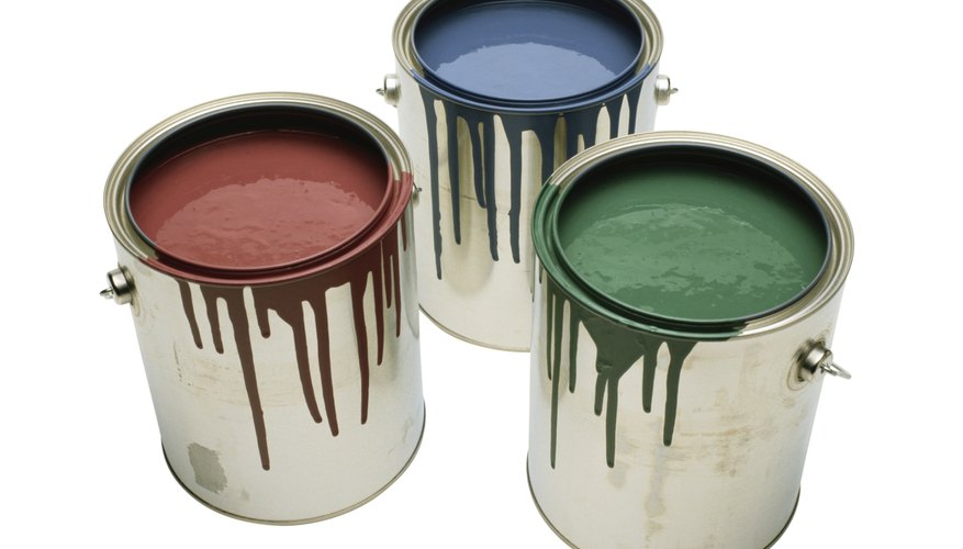 These full one-gallon cans of paint don't weigh the same as they would if filled with water.