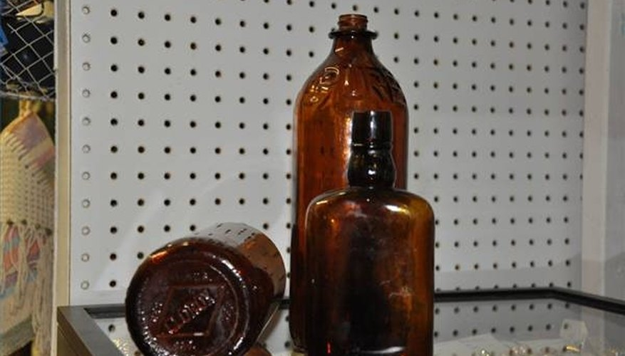 These old clorox and alcohol bottles are made of amber glass.