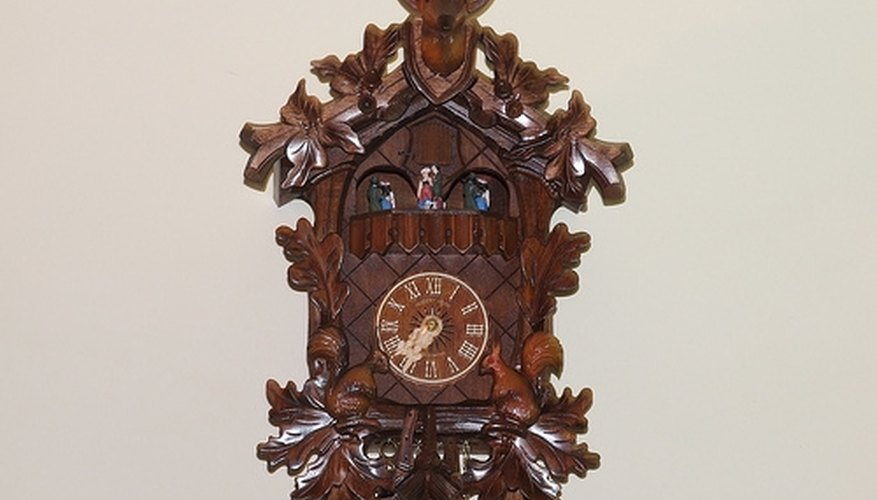 Cuckoo clock with traditional stag's head decoration.