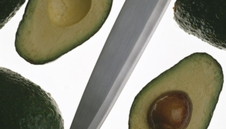 Carefully remove the whole pit from the avocado.
