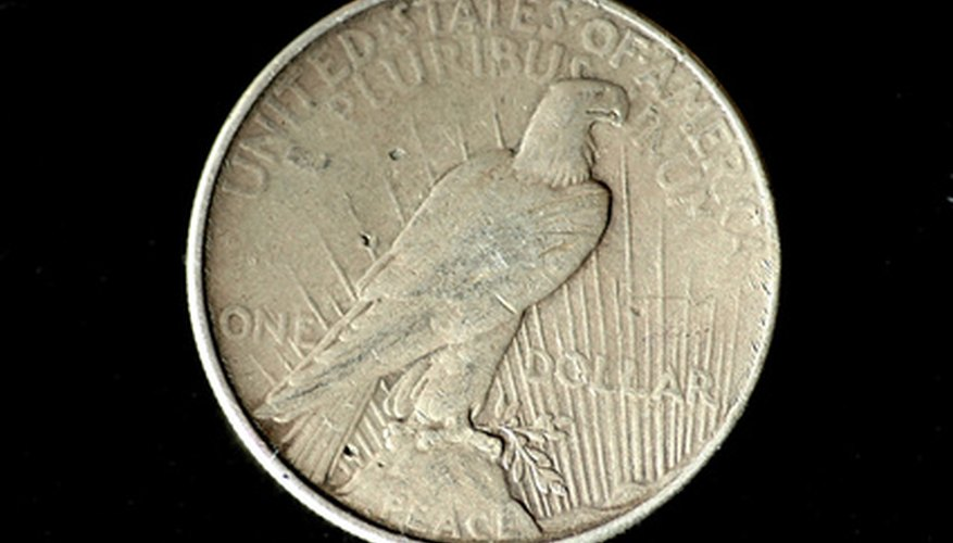 "The reverse side of a Peace Dollar, showing the word ""Peace"" near the lower rim."