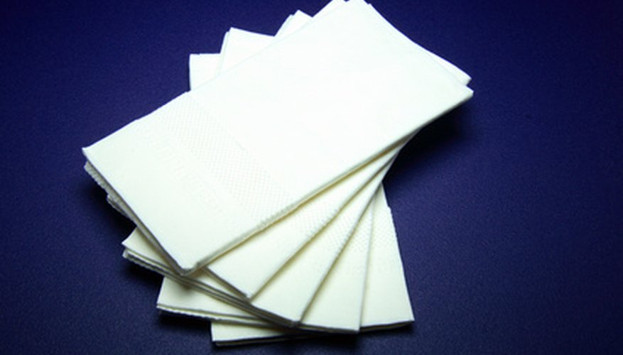 Crafting of a simple handkerchief doll begins with a man's white handkerchief.
