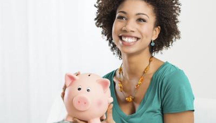 teenage girl with piggy bank