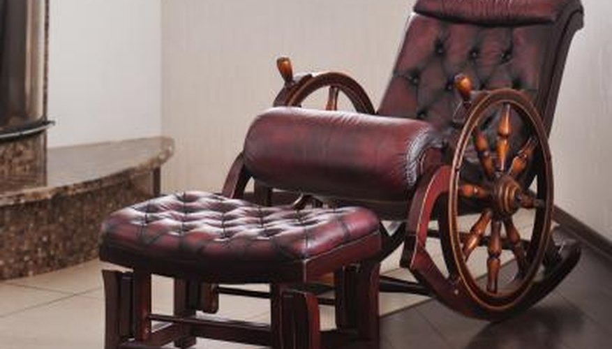 An old-fashioned wooden rocking chair with leather upholstery.