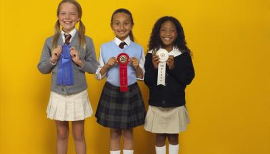 3 young girls with Science Fair ribbons.