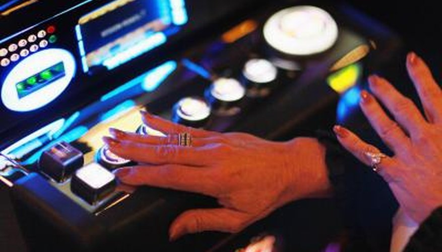 Hand of woman touching button on slot machine