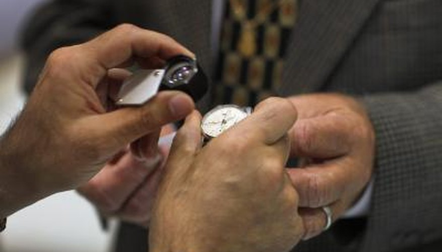 A watch being examined by professional