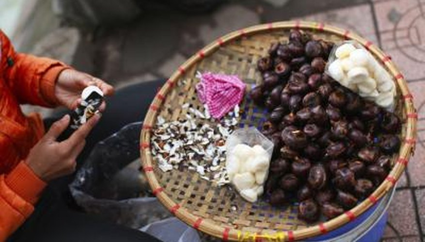Water chestnuts being peeled