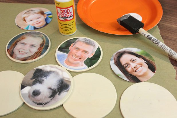 Decoupage photos onto wood discs