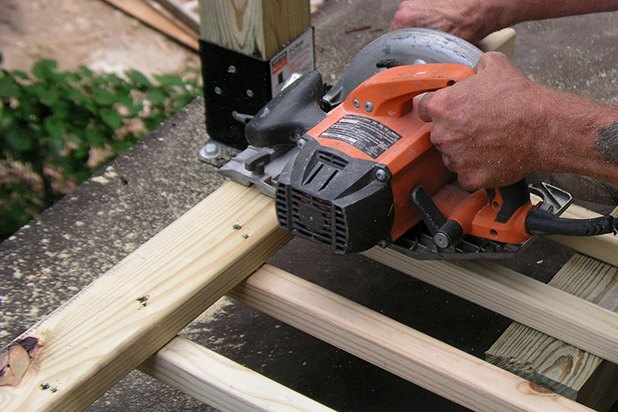 Cut between balusters or remove one according to your measurements.