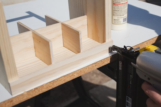 Attaching the wood slats on the outside.