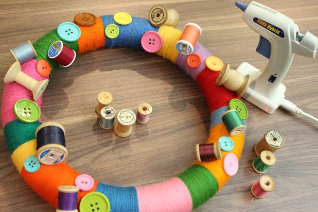 Glue spools of thread to the wreath