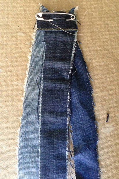 Pin your first three strips of denim together.