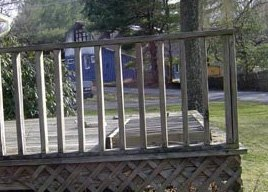 A simple, standard deck railing made from inexpensive wood pickets