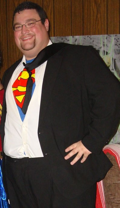 Guy dressed as Clark Kent as Superman