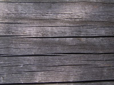 Weathered wood can be repainted while preserving the aged look.