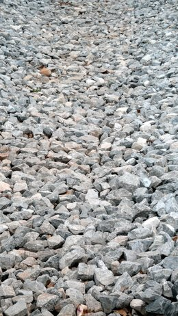 Gravel is inexpensive and easy to spread in driveway areas that need resurfacing.