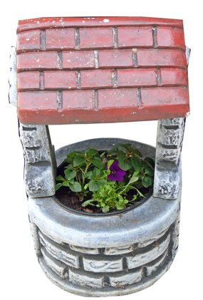 Place large decorative pots around it or on top of it.