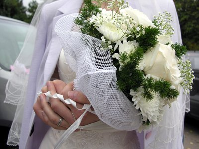 White carnations are included in this bridal bouquet.