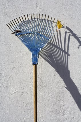 Use a rake to spread the sand evenly.