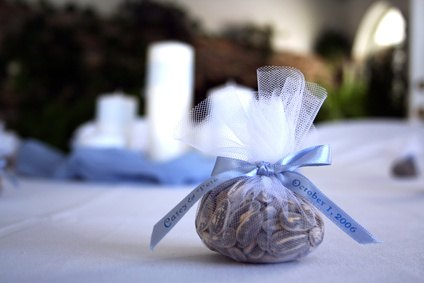 Wedding guests can find door gifts at reception tables.