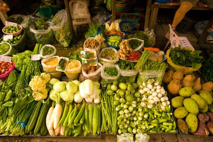 Selling vegetables at a market