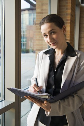 A female law student should wear professional attire when representing her school.