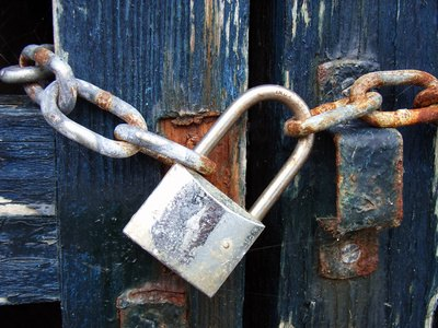 Padlocks work well when using a chain.
