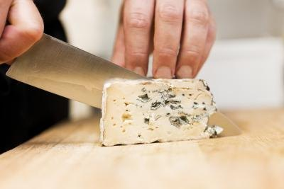 slicing blue cheese