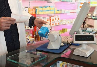 Pharmacist scans medication