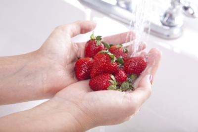 Woman washing strawberries