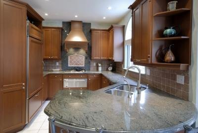 Composite granite sinks may be installed over or under the counter.