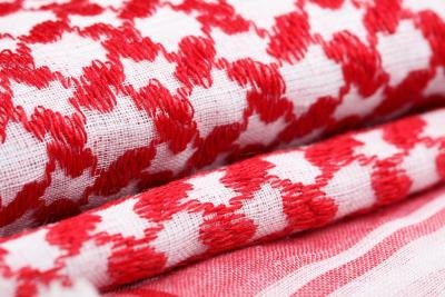 folded blankets with red and white