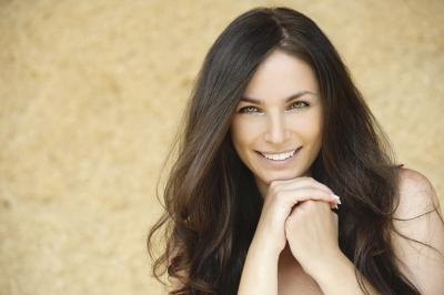 Young woman smiling with long hair.