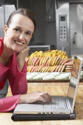 Bakery owner on computer