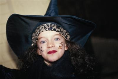 Young girl in witch costume.