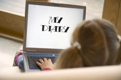 A child writing in a digital diary.