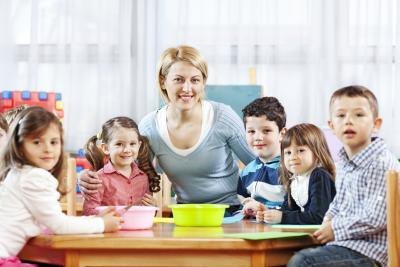 day care worker with children