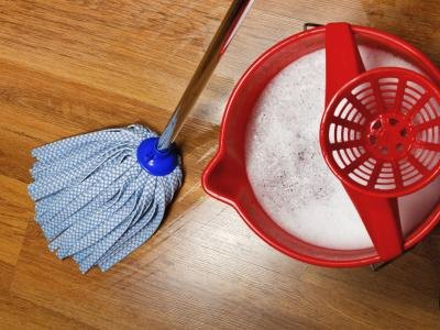 Pour 2 oz. of household dish detergent and 8 oz. of household bleach into your cleaning solution bucket.