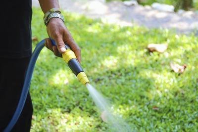 Close-up of hose in hand