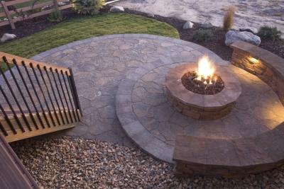 A stone bench and or fire pit can bring your pebble garden to life.