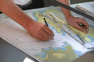 Cartographer marking up map