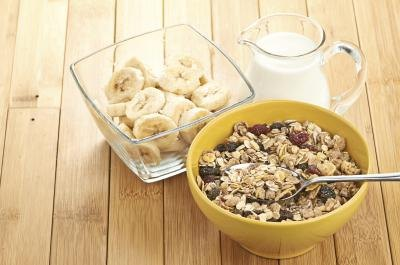 Bowl of cereal paired with small bowl of sliced bananas.